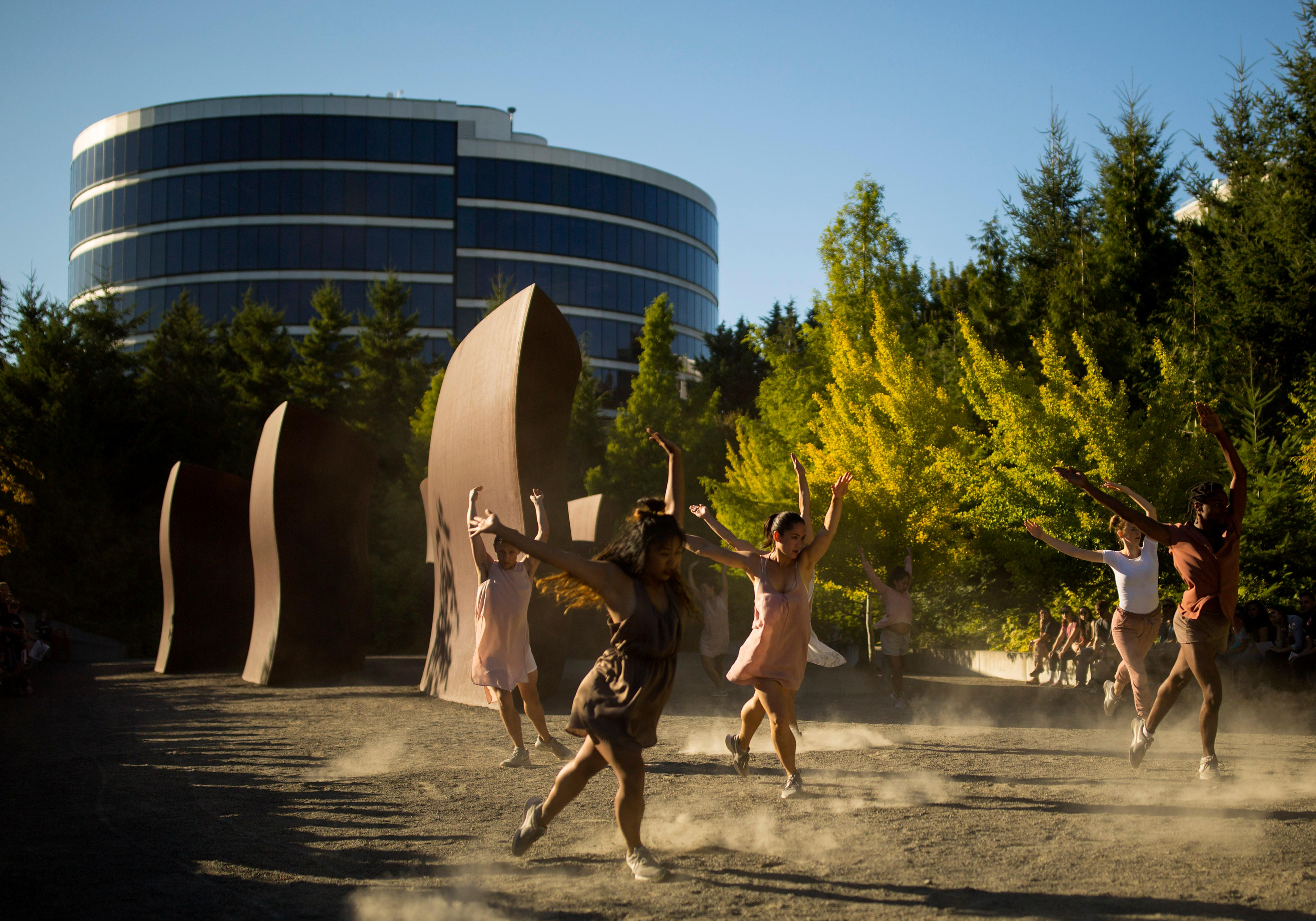 Dancers took over the Olympic Sculpture Park Thursday evening for a second year in a row as the Pacific Northwest Ballet returned with new site-specific dance works presented during the free Summer at SAM series. As part of The Wallace Foundation's Building Audiences for Sustainability initiative, PNB commissioned works from four local choreographers (Noelani Pantastico, Dani Tirrell, Price Suddarth, Eva Stone), created in conversation with sculptures on-site at the park. (Sy Bean / Seattle Refined)