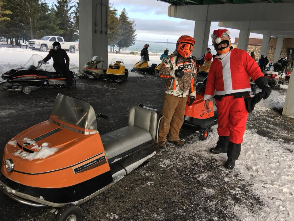 Dozens of antique and vintage snowmobiles crossed The Mighty Mac as part of the 2nd Annual Bridge Crossing. Photo Courtesy: Top of the Lake Snowmobile Museum<p></p>