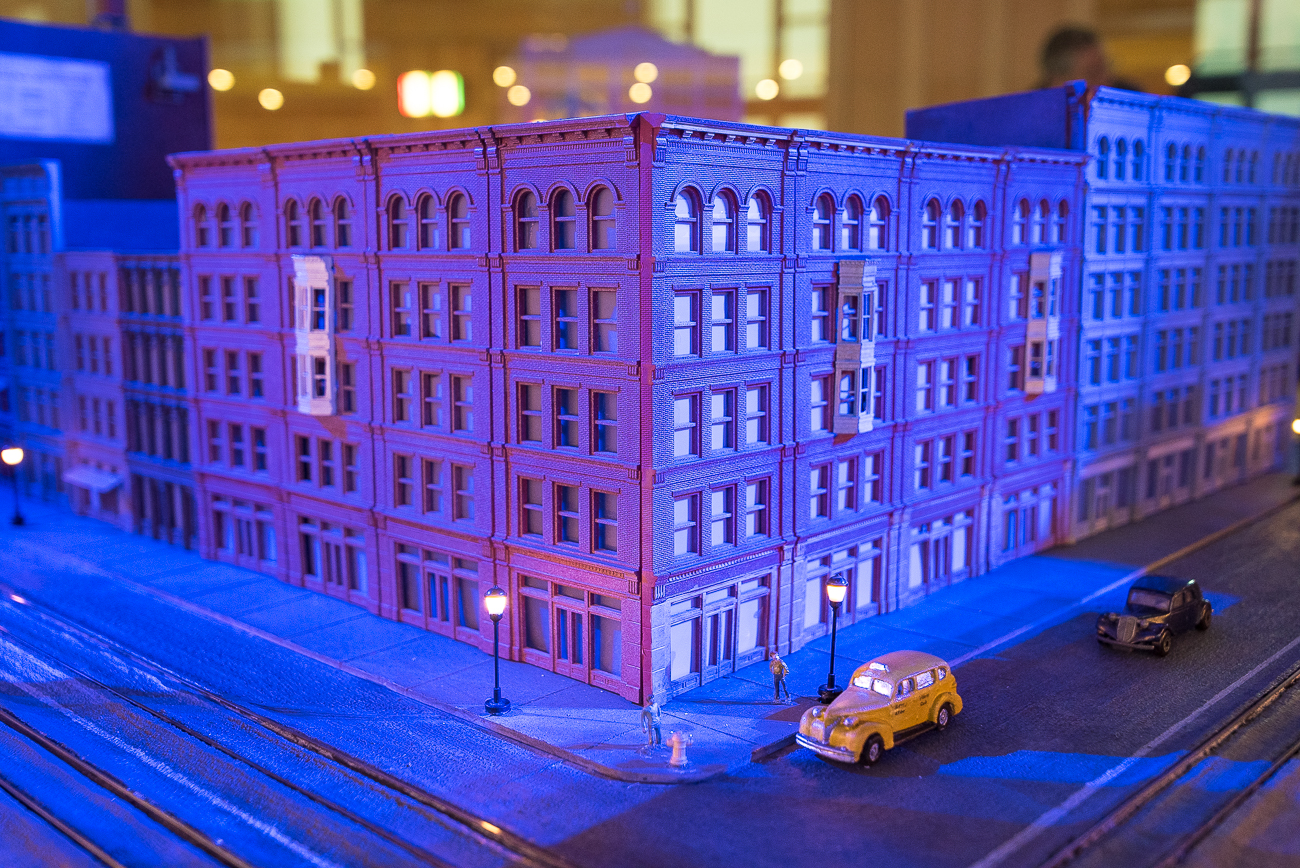 Following three years of construction, the Cincinnati Museum Center's 'Cincinnati in Motion' exhibit makes its way back to the Cincinnati wing of Union Terminal. The downtown area of the nation's largest full-motion urban diorama has been cleaned, updated, and reconstructed in its original location. The miniature city depicts a 1940s version of Cincinnati, and features prominent local icons such as Roebling Bridge, Carew Tower, Taft Museum, and many others. Miniature streetcars buzz about the city during a looping night and day sequence that alters the appearance of the city as visitors observe it. Cincinnati in Motion opens March 22. / Image: Phil Armstrong, Cincinnati Refined // Published: 3.22.19