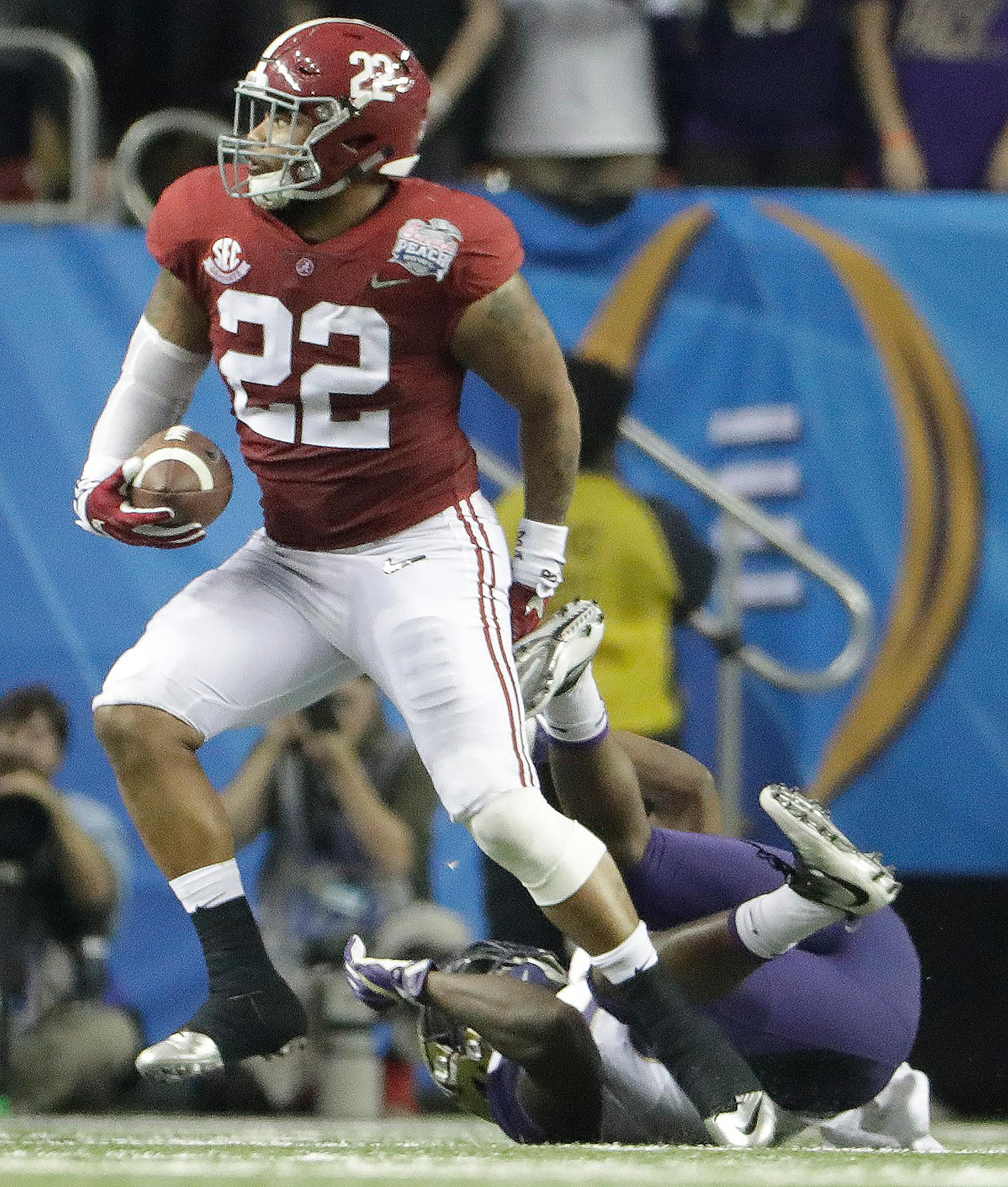 Alabama linebacker Ryan Anderson (22) was selected by the Redskins in the second round with pick no. 49. Anderson picks off a pass intended for Washington running back Lavon Coleman (22) during the first half of the Peach Bowl NCAA college football playoff game, Saturday, Dec. 31, 2016, in Atlanta. (AP File Photo/David Goldman)
