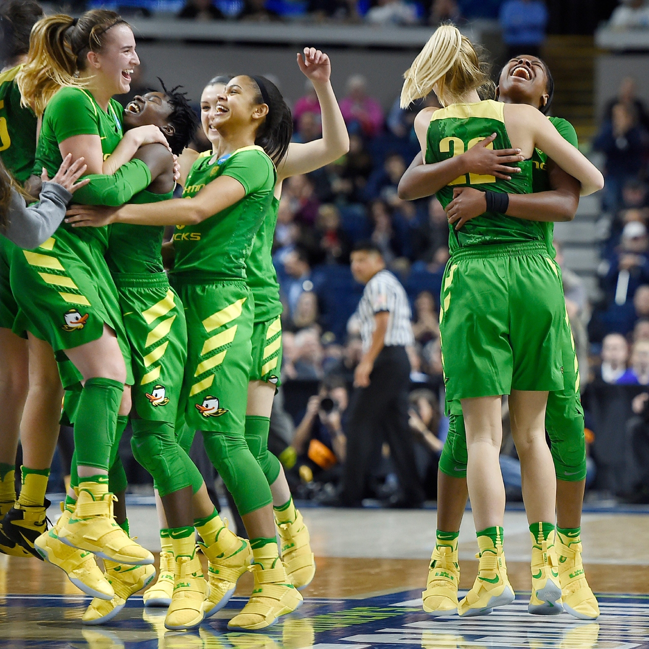 Oregon players celebrates their win over Maryland in a regional semifinal game in the NCAA women's college basketball tournament, Saturday, March 25, 2017, in Bridgeport, Conn. (AP Photo/Jessica Hill)