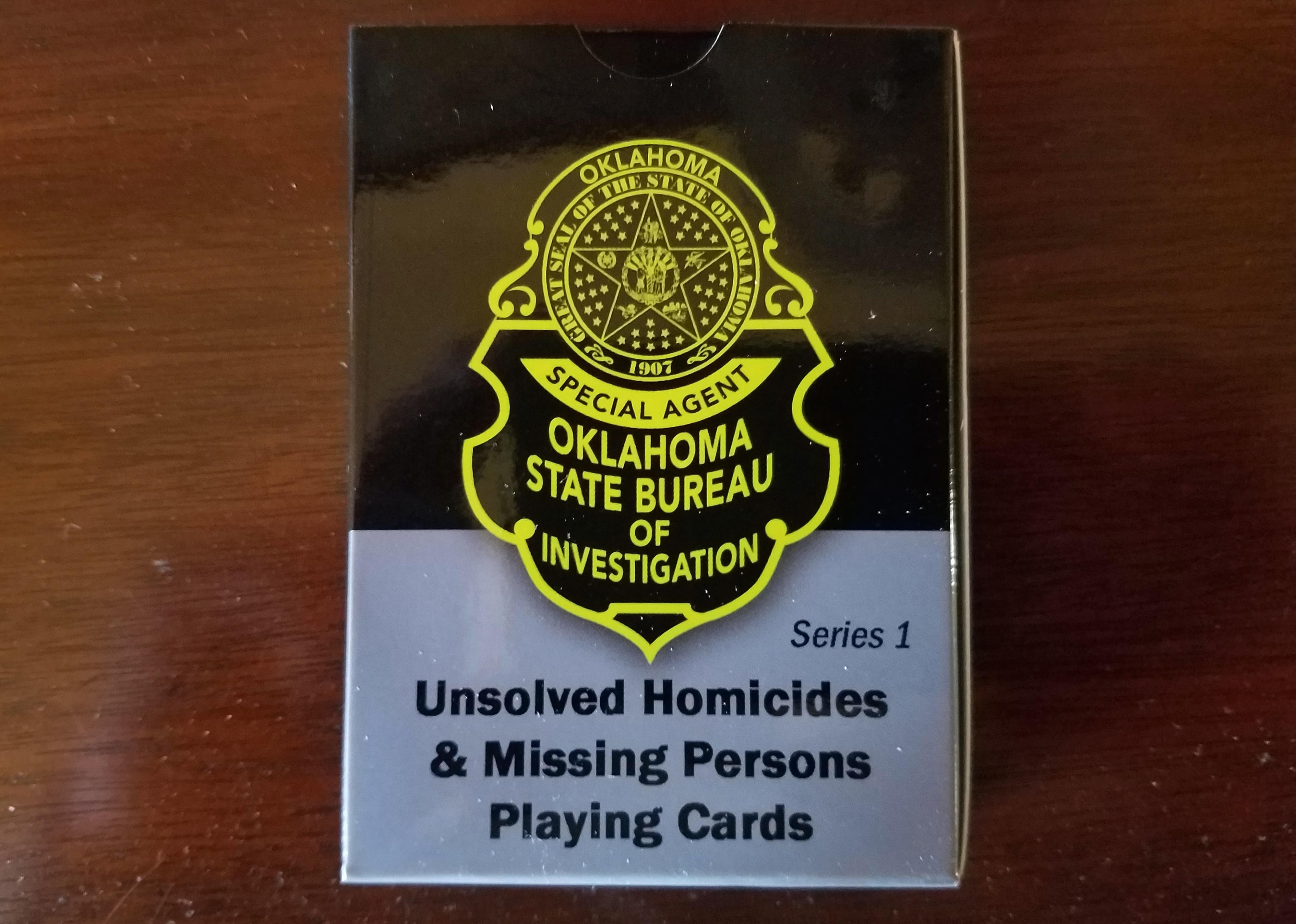 This Wednesday, Oct. 11, 2017 photo shows Oklahoma State Bureau of Investigation's unsolved Homicides & Missing Persons Playing Cards in Oklahoma City. Oklahoma State Bureau of Investigation Director and Oklahoma Department of Correction Director have joined to sell the state prison inmates the playing cards. (Oklahoma State Bureau of Investigation via AP)