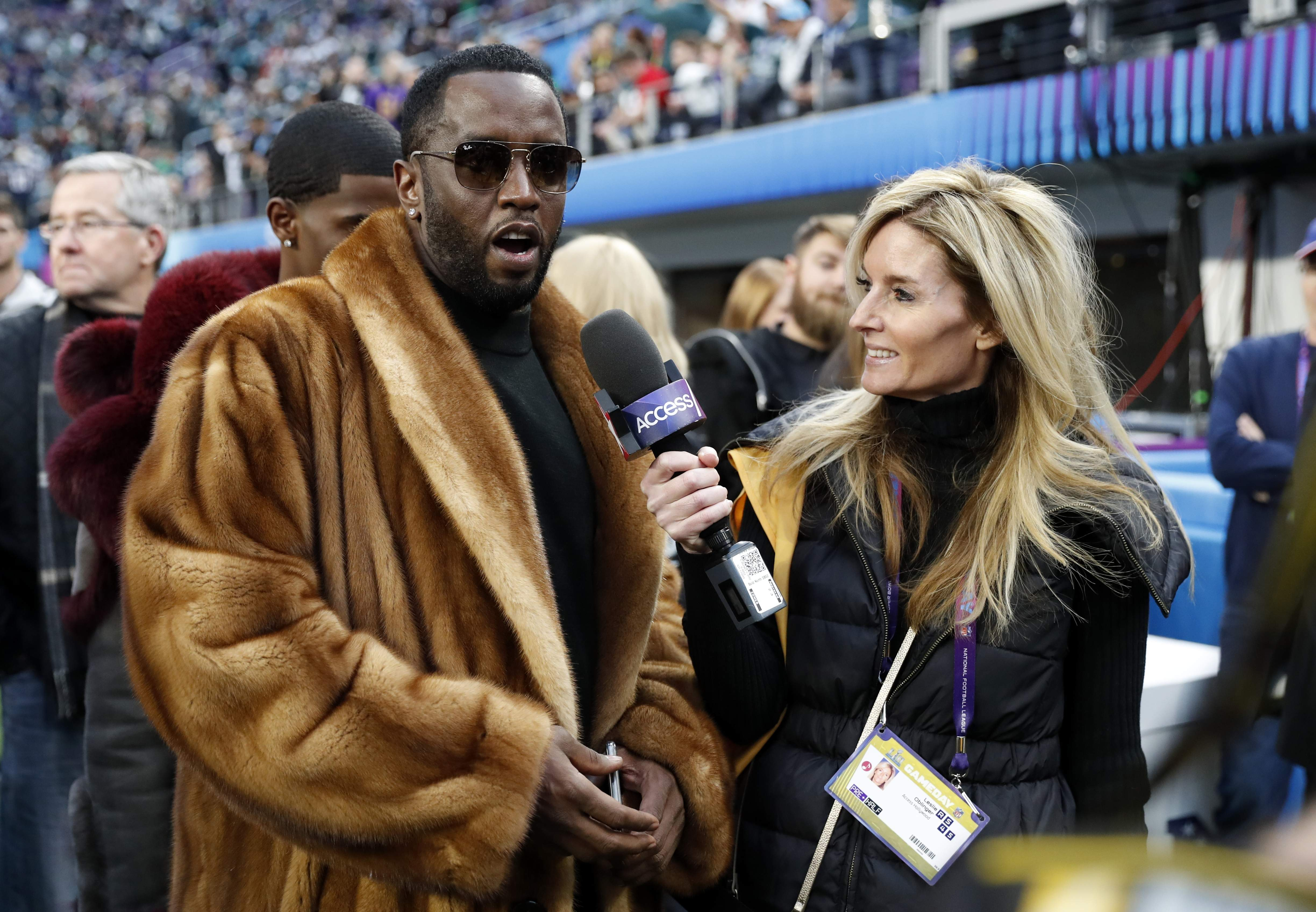 Musician Sean 'P. Diddy' Combs, left, is interviewed before the NFL Super Bowl 52 football game between the Philadelphia Eagles and the New England Patriots Sunday, Feb. 4, 2018, in Minneapolis. (AP Photo/Matt York)