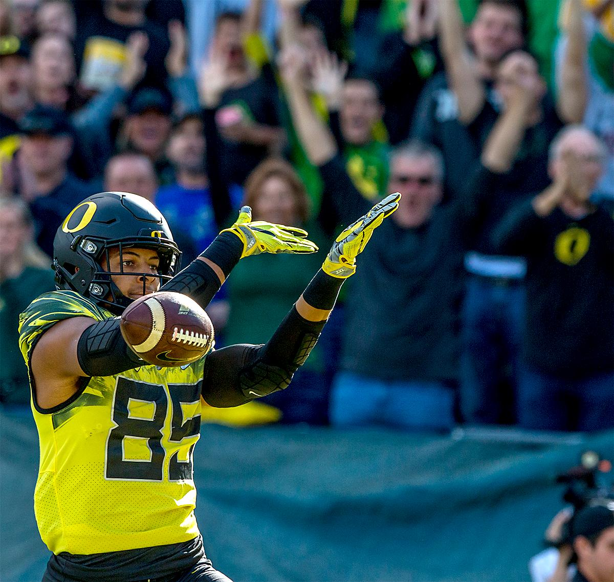 The Duck's Pharaoh Brown (#85) lets the ball go as he celebrates his touchdown. The Oregon Ducks broke their losing streak by defeating the ASU Sun Devils on Saturday 54-35. Photo by August Frank, Oregon News Lab
