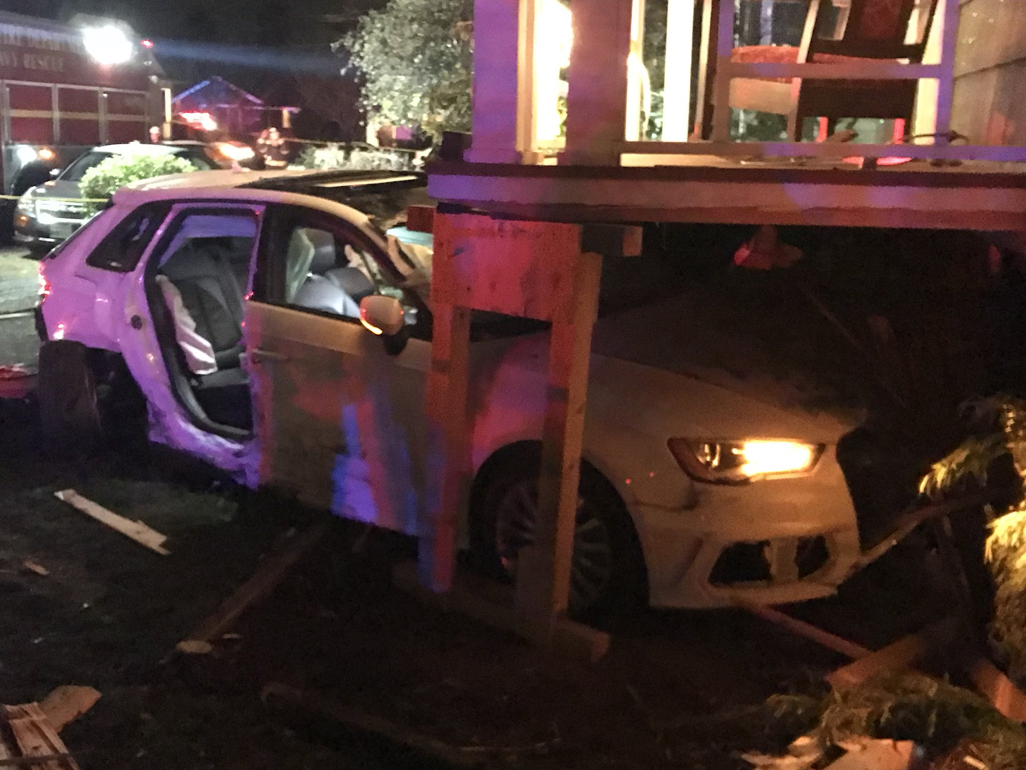 Emergency crews freed a driver trapped in a stolen car Monday night after it hit a natural gas line and smashed into a house in the University District.{ } (Photo: Seattle Fire)