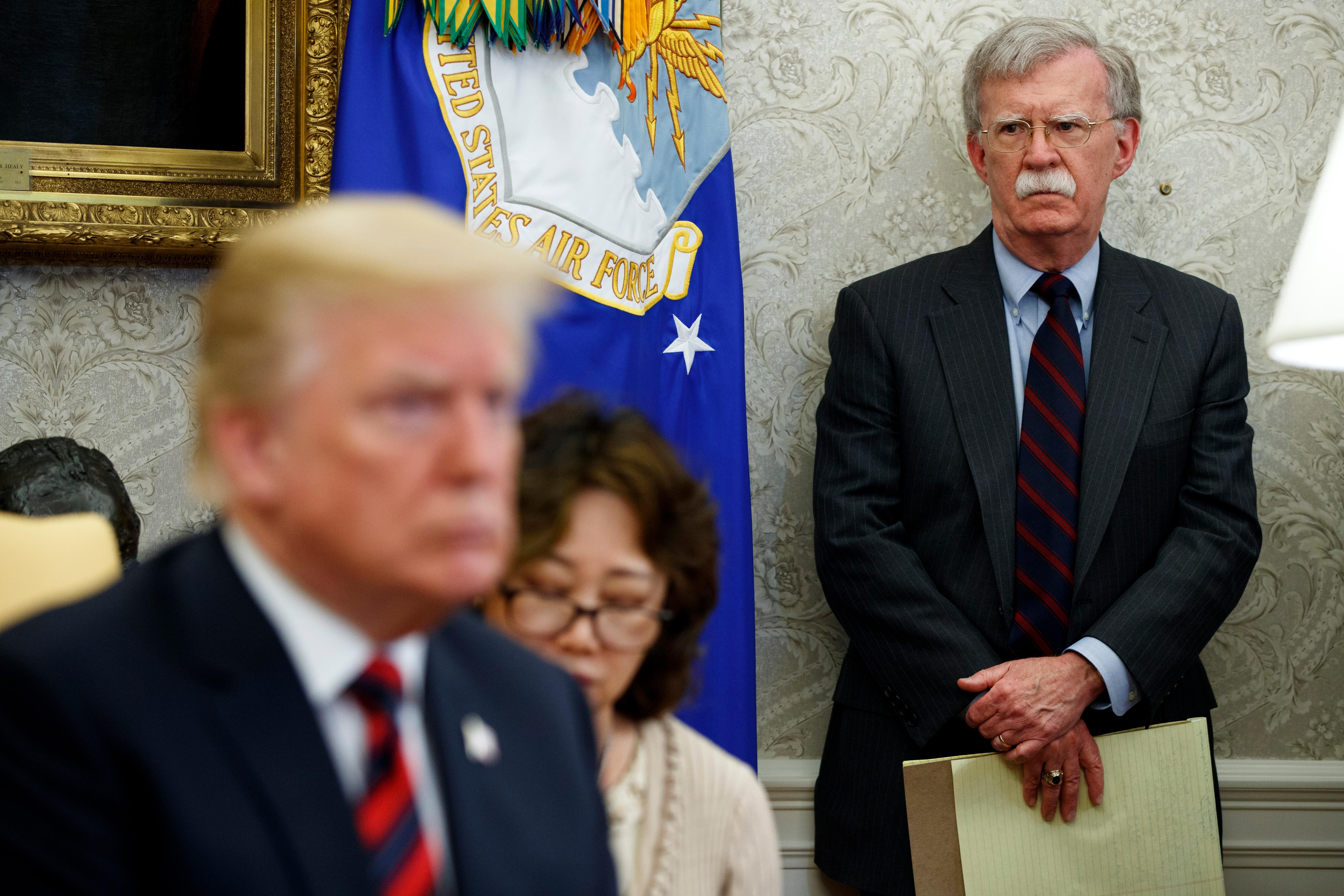 President Donald Trump meets with South Korean President Moon Jae-In in the Oval Office of the White House, Tuesday, May 22, 2018, in Washington, as national security adviser John Bolton watches. (AP Photo/Evan Vucci)