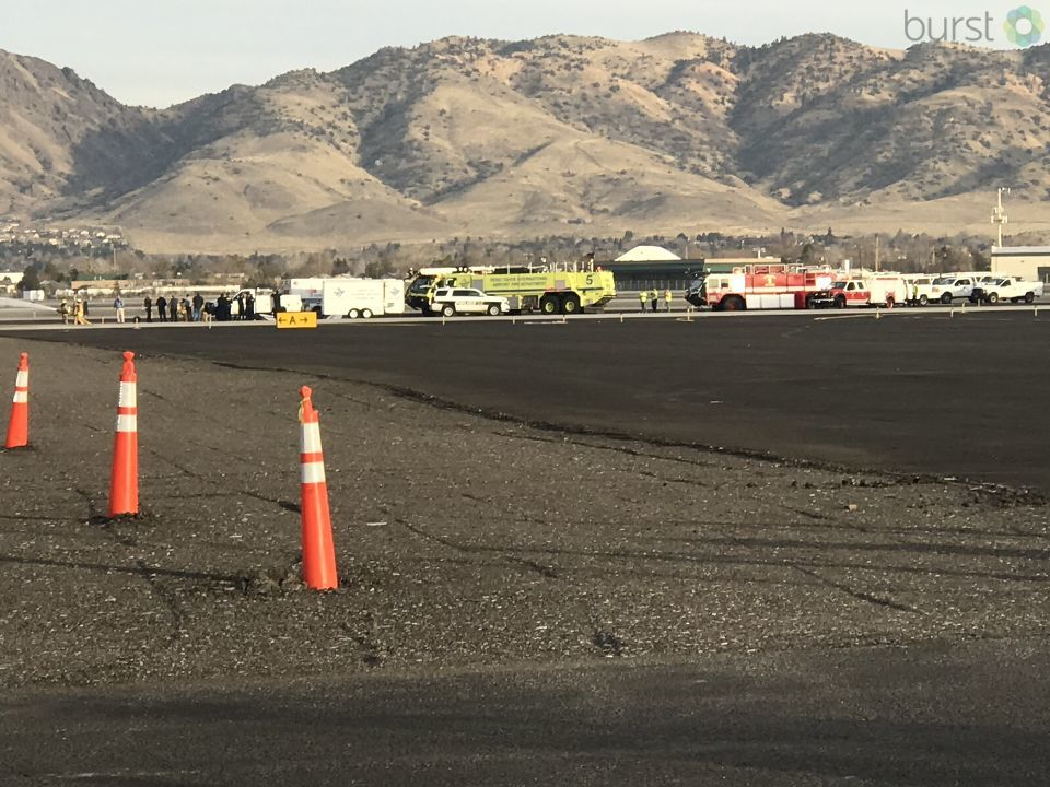 Emergency personnel can be seen responding to a plane that made a hard landing at Reno-Tahoe International Airport on Wednesday, Jan. 17, 2018. (KRNV/KRXI)