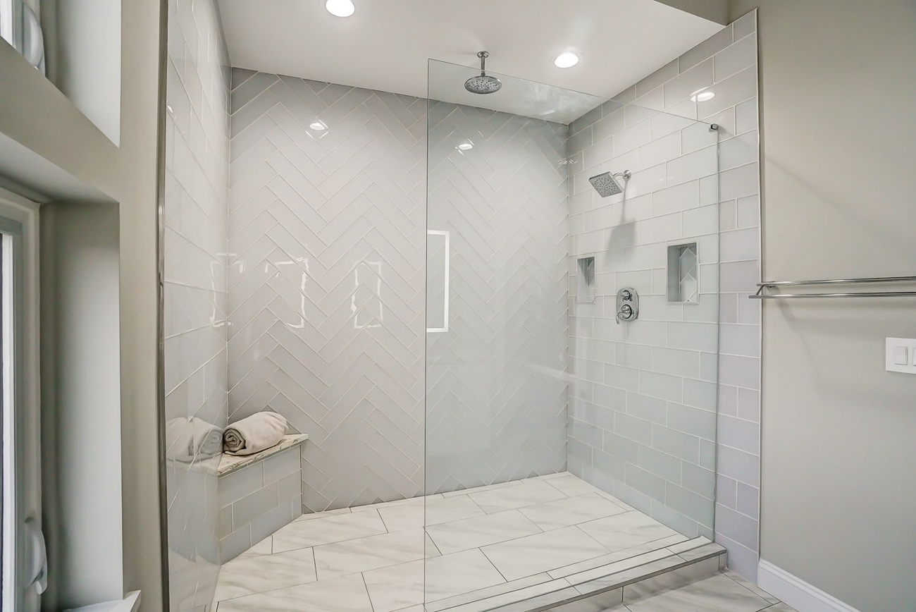 The master shower offers a choice of rainfall or standard shower heads. / Image courtesy of Kelly Gibbs, Coldwell Banker // Published: 12.28.18
