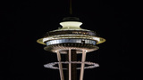 Watch: Crews hoist 28,000 pound construction platform up around the Space Needle