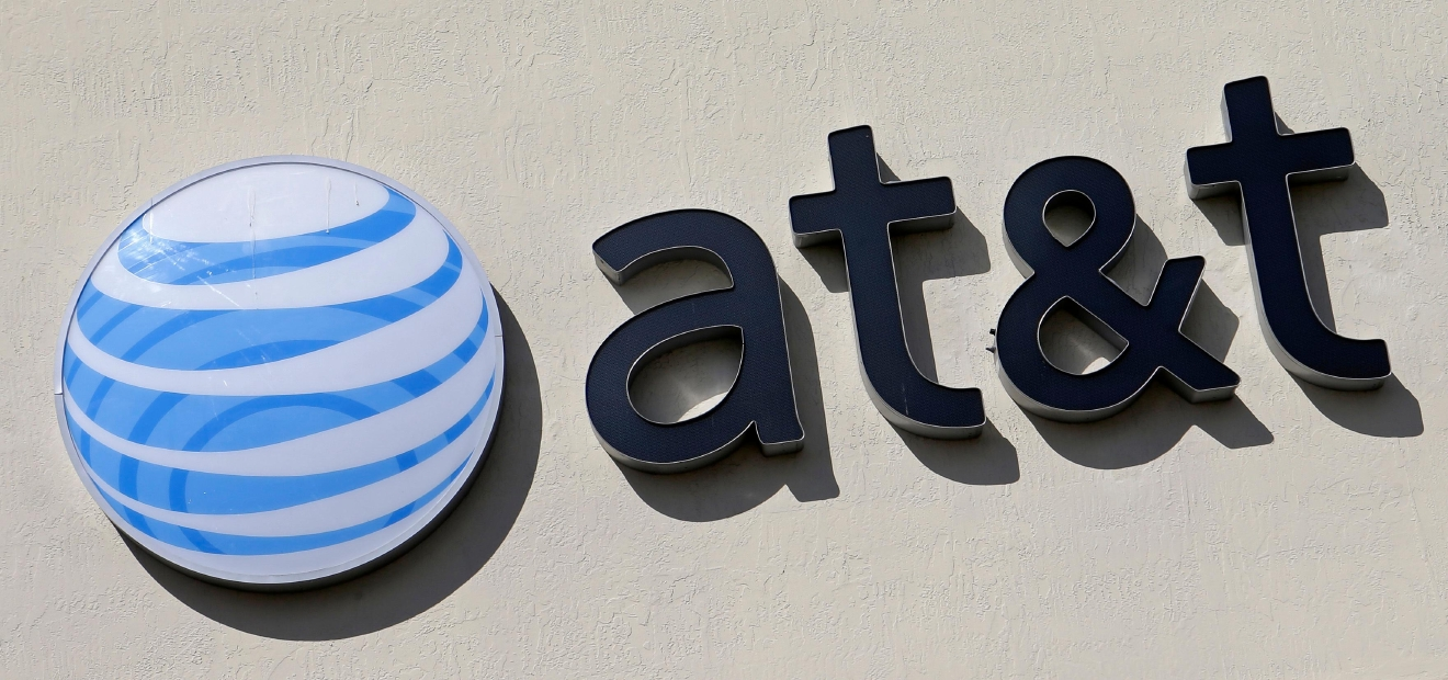 FILE - This Wednesday, Feb. 8, 2017, file photo shows the AT&T sign at a store in Hialeah, Fla.  (AP Photo/Alan Diaz, File)