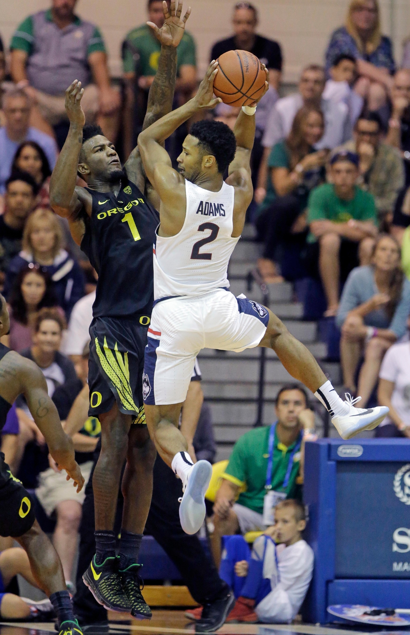 Oregon forward Jordan Bell (1) defends against Connecticut guard Jalen Adams (2) in the first half during an NCAA college basketball game in the Maui Invitational Wednesday, Nov. 23, 2016, in Lahaina, Hawaii. (AP Photo/Rick Bowmer)