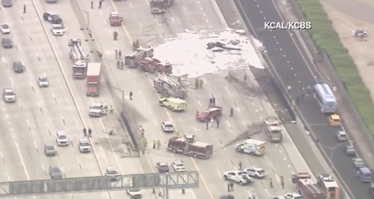 Orange County Fire Capt. Larry Kurtz says the plane crashed on Interstate 405 near John Wayne Airport in Costa Mesa around 9:30 a.m. Friday.  (Still from KCAL/ CNN Newsource)