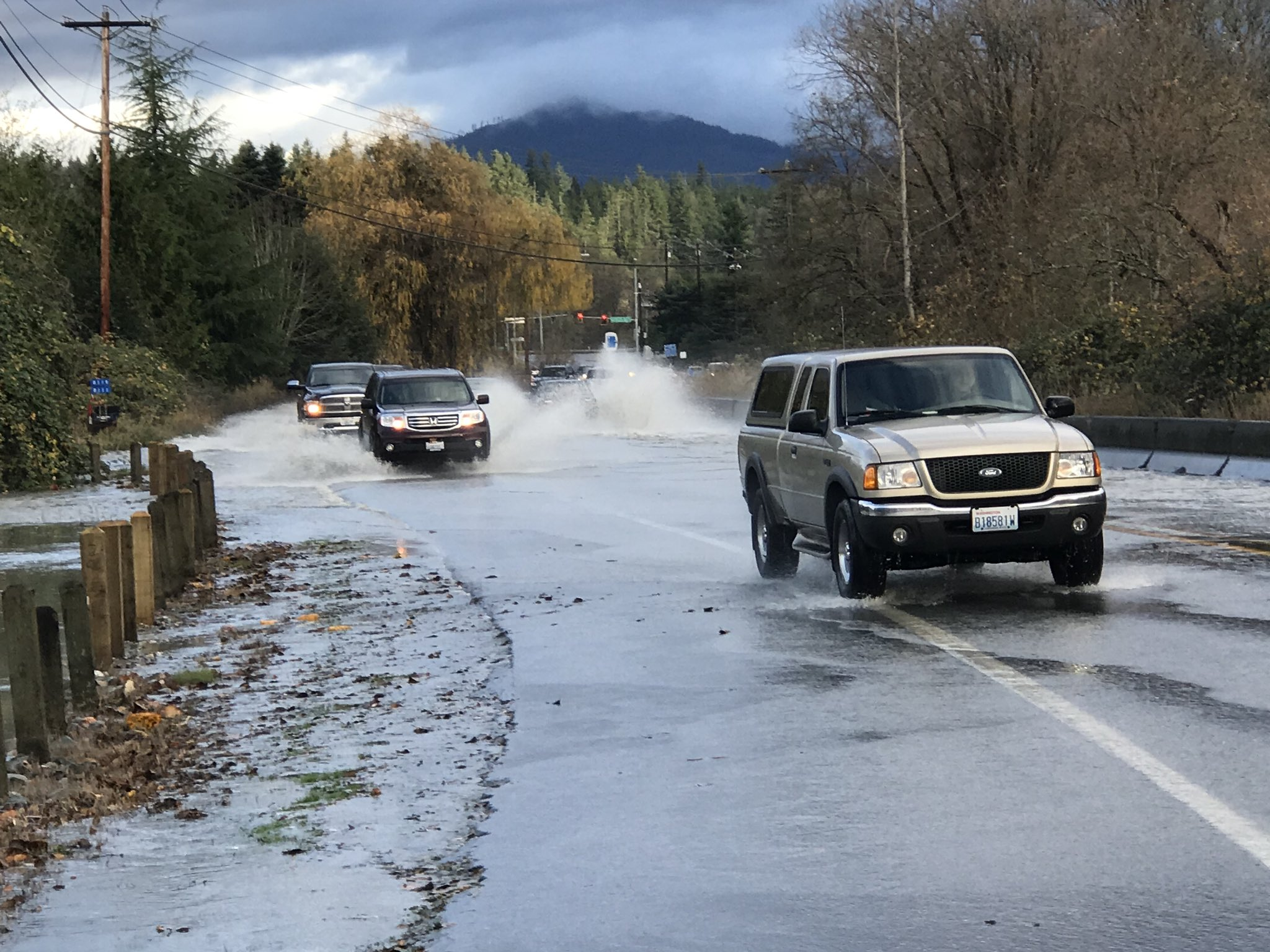 Water from the Stillaguamish River floods over SR-530 near Arlington. (Photo: Benjamin Jurkovich)