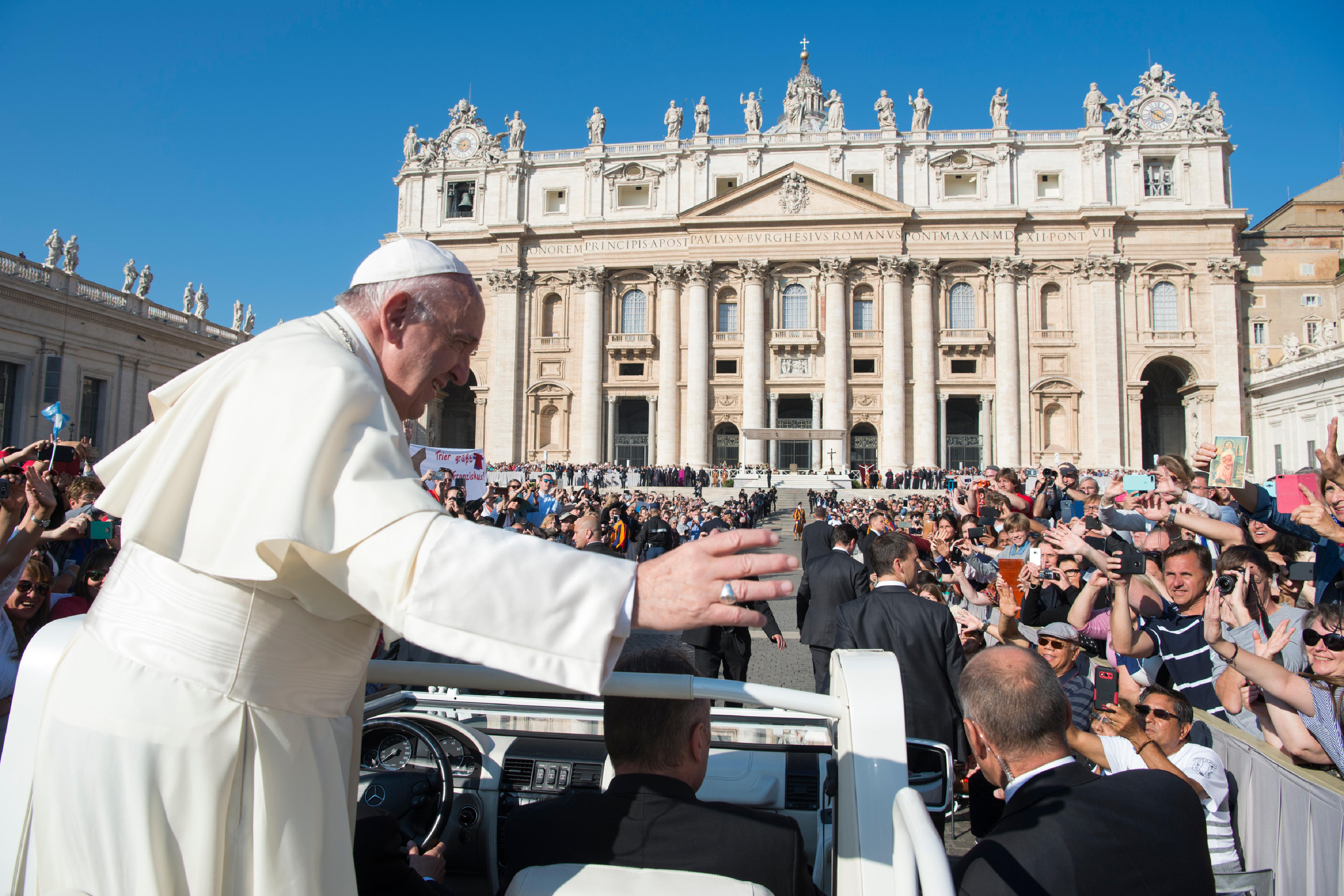 Pope Francis waves from his pope-mobile as he is driven through the crowd ahead of his weekly general audience, in St. Peter's Square, at the Vatican, Wednesday, Oct. 4, 2017.  (L'Osservatore Romano/Pool Photo via AP)