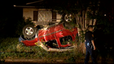 Driver going too fast flips SUV, lands in front yard of home, say investigators