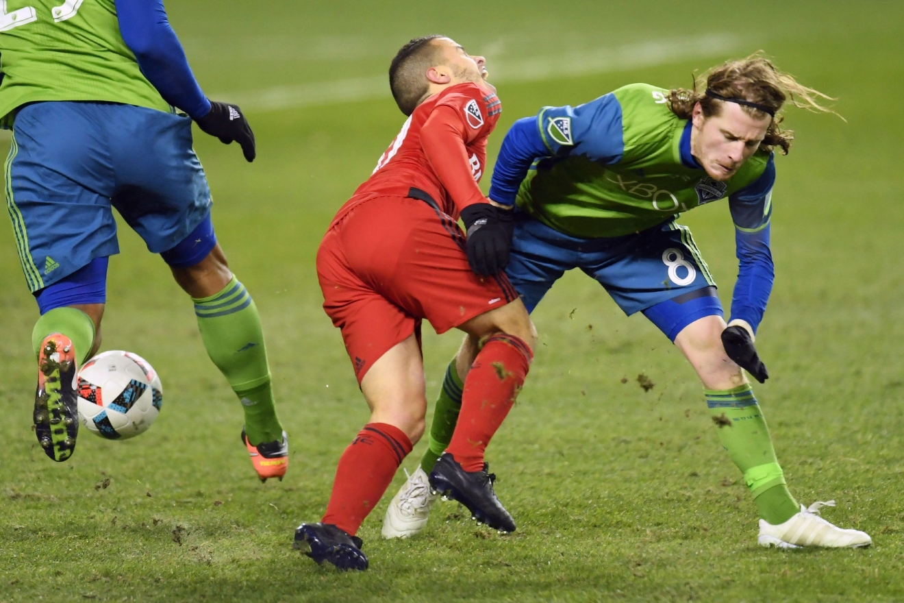 Toronto FC forward Sebastian Giovinco (10) is tackled by Seattle Sounders midfielder Erik Friberg (8) during first-half MLS Cup final soccer action in Toronto, Saturday, Dec. 10, 2016. (Frank Gunn/The Canadian Press via AP)