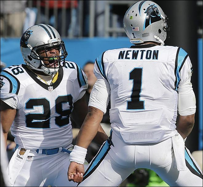 Carolina Panthers running back Jonathan Stewart (28) celebrates his touchdown with Carolina Panthers quarterback Cam Newton (1) against the Seattle Seahawks during the first half of an NFL divisional playoff football game, Sunday, Jan. 17, 2016, in Charlotte, N.C. (AP Photo/Chuck Burton)