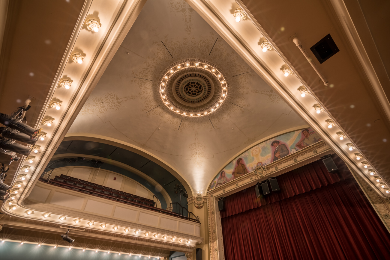 In 1906, a theater was added to the library and served as a Covingtonian gathering place for political and theatrical events. The mural above the stage, entitled The Spirit of Covington, was painted by Kentucky artist Harlan Hubbard in 1934. / Image: Phil Armstrong, Cincinnati Refined // Published: 5.18.17