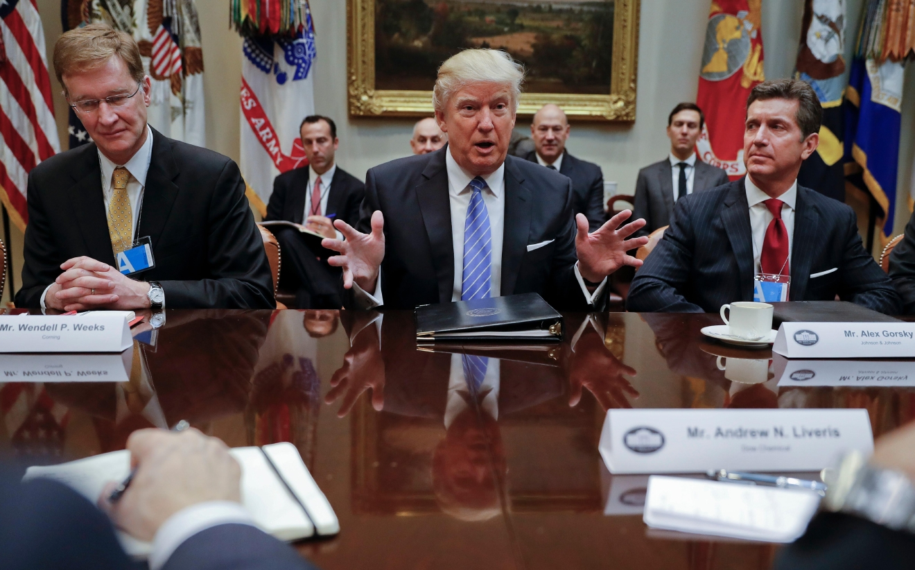 President Donald Trump speaks while hosting a breakfast with business leaders in the Roosevelt Room of the White House in Washington, Monday, Jan. 23, 2017. At left is Wendell P. Weeks, Chief Executive Officer of Corning at right is Alex Gorsky, chairman and chief executive officer of Johnson & Johnson. (AP Photo/Pablo Martinez Monsivais)