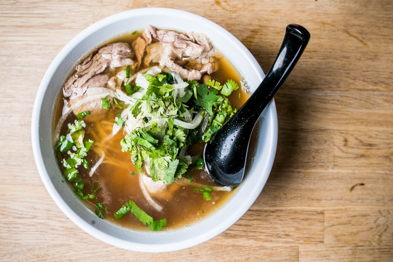 Tai, Nam Pho: Beef soup, rare steak, brisket, rice noodles, sliced onions, scallions, and cilantro / Image: Amy Elisabeth Spasoff // Published: 3.2.18