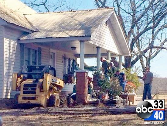 Authorities continue their search for the possible remains of a woman missing since 2009 at a home in Cullman County, Ala., Saturday, March 8, 2014.