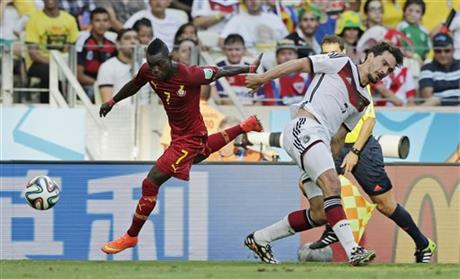 Ghana's Christian Atsu, left, gets away from Germany's Mats Hummels during the group G World Cup soccer match at the Arena Castelao in Fortaleza, Brazil, Saturday, June 21, 2014.