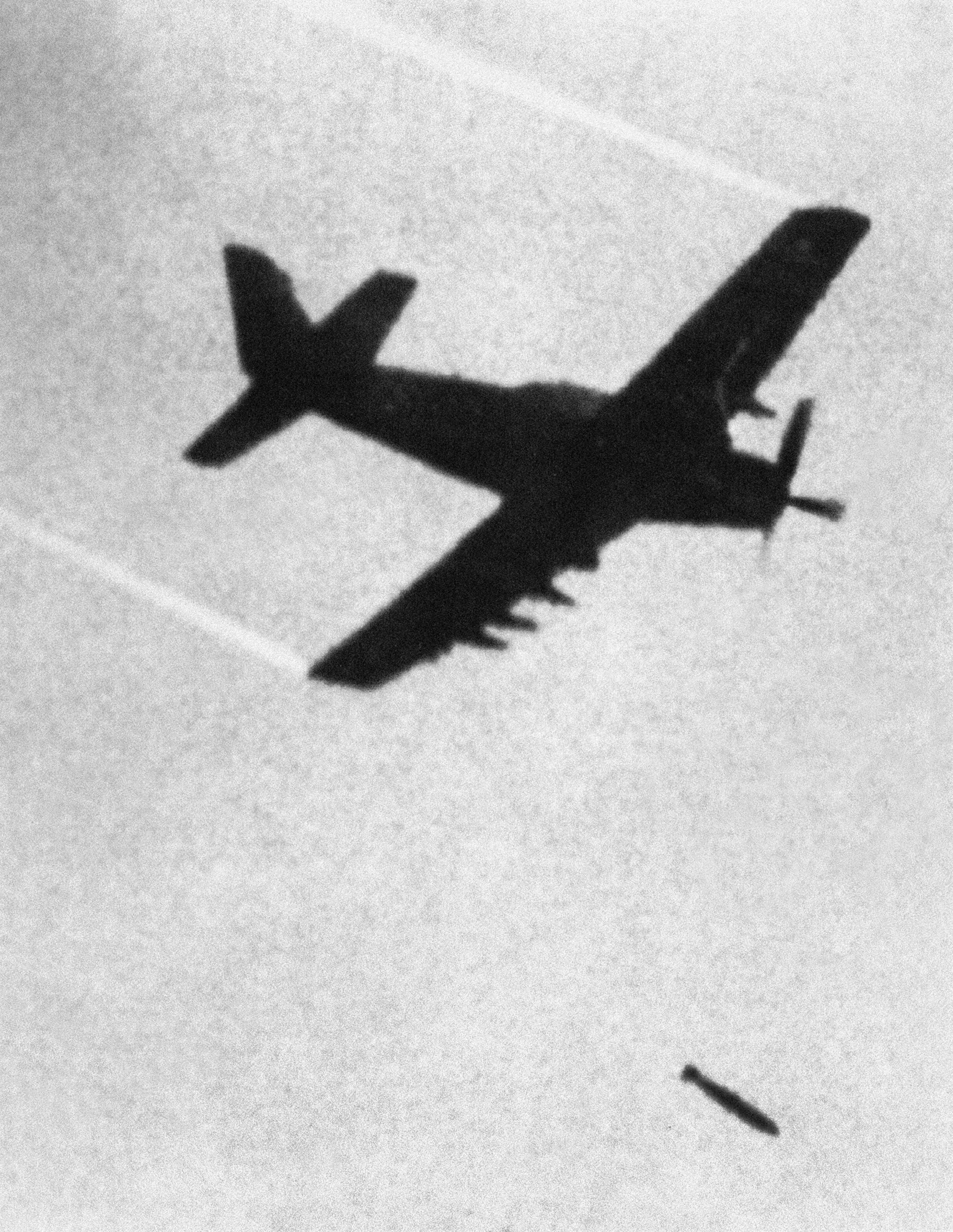 In this June 8, 1972, file photo taken by Associated Press photographer Huynh Cong 'Nick' Ut, a Skyraider, a propeller driven plane of the Vietnamese Airforce (VNAF) 518th Squadron, drops a bomb with incendiary napalm and white phosphorus jelly over Trang Bang village. NICK UT/THE ASSOCIATED PRESS