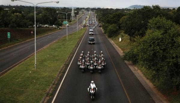 Motorcycles escort Mandela's hearse.Click the photo for the full story.
