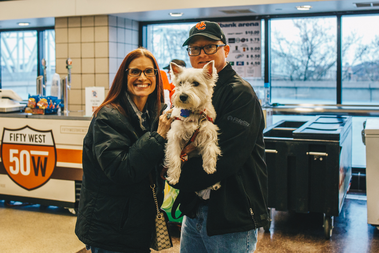 Lexie with humans Julie & Joe Tunney{ }/ Image: Catherine Viox // Published: 3.21.19