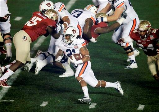 Auburn's Tre Mason runs during the first half of the NCAA BCS National Championship college football game against Florida State Monday, Jan. 6, 2014, in Pasadena, Calif.