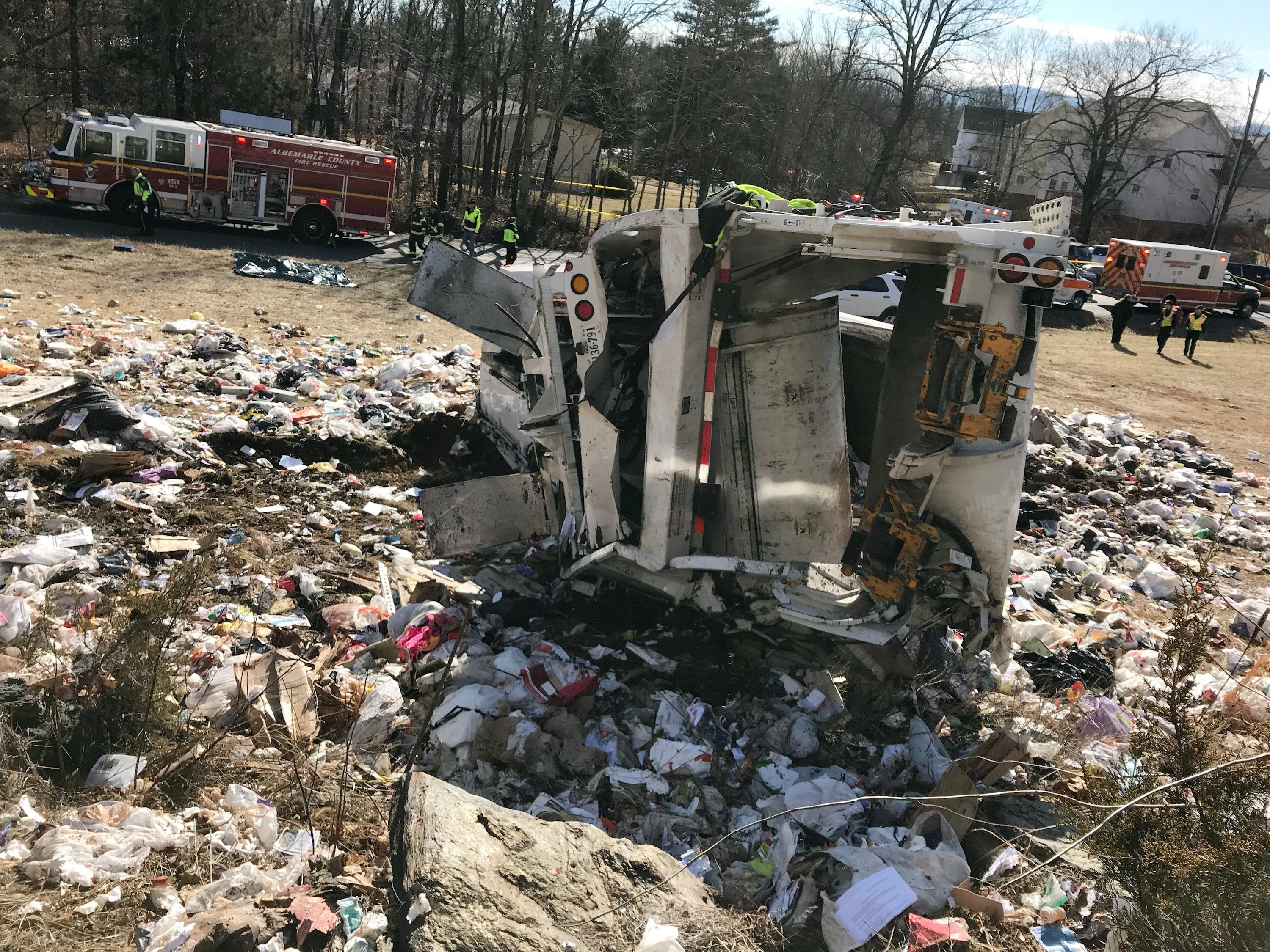 This photo provided by Rep. Greg Walden, R-Oregon, shows a crash site near Crozet, Va., Wednesday, Jan. 31, 2018.   A chartered train carrying dozens of GOP lawmakers to a Republican retreat in West Virginia struck a garbage truck south of Charlottesville, Virginia on Wednesday, lawmakers said. (Rep. Geg Walden via AP)