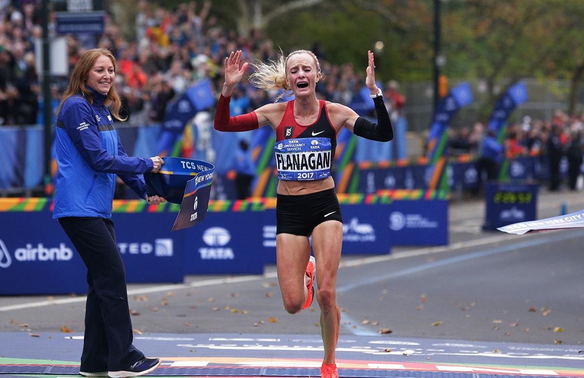 Shalane Flanagan crosses the finish line first in the women's division of the New York City Marathon in New York, Sunday, Nov. 5, 2017. (AP Photo/Seth Wenig)