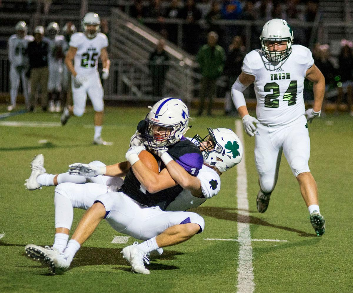 South Eugene Axemen Elliot James (#1) attempts to keep control of the ball as Sheldon Irish defense tackles him. Sheldon Irish defeated South Eugene Axemen 63-6 on Friday night at South Eugene Highschool in Eugene, Ore. Photo by Rhianna Gelhart, Oregon News Lab