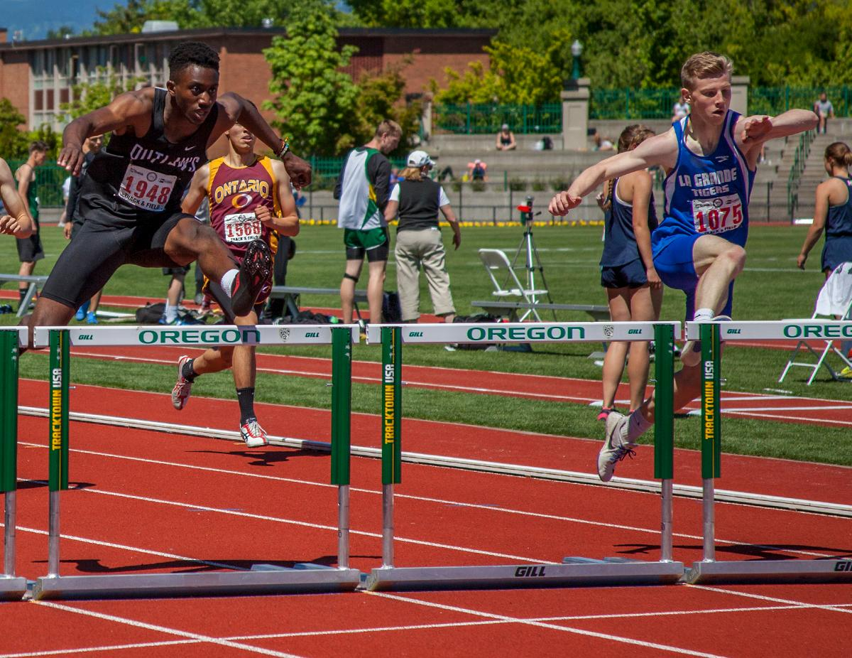 Cade Reed (right) from La Grande High School wins Boys 300 Meter Hurdles 4A Prelims event with the time of 40.59 at the OSAA Track and Field State Championships at Hayward Field. Photo by Vannie Cooper, Oregon News Lab