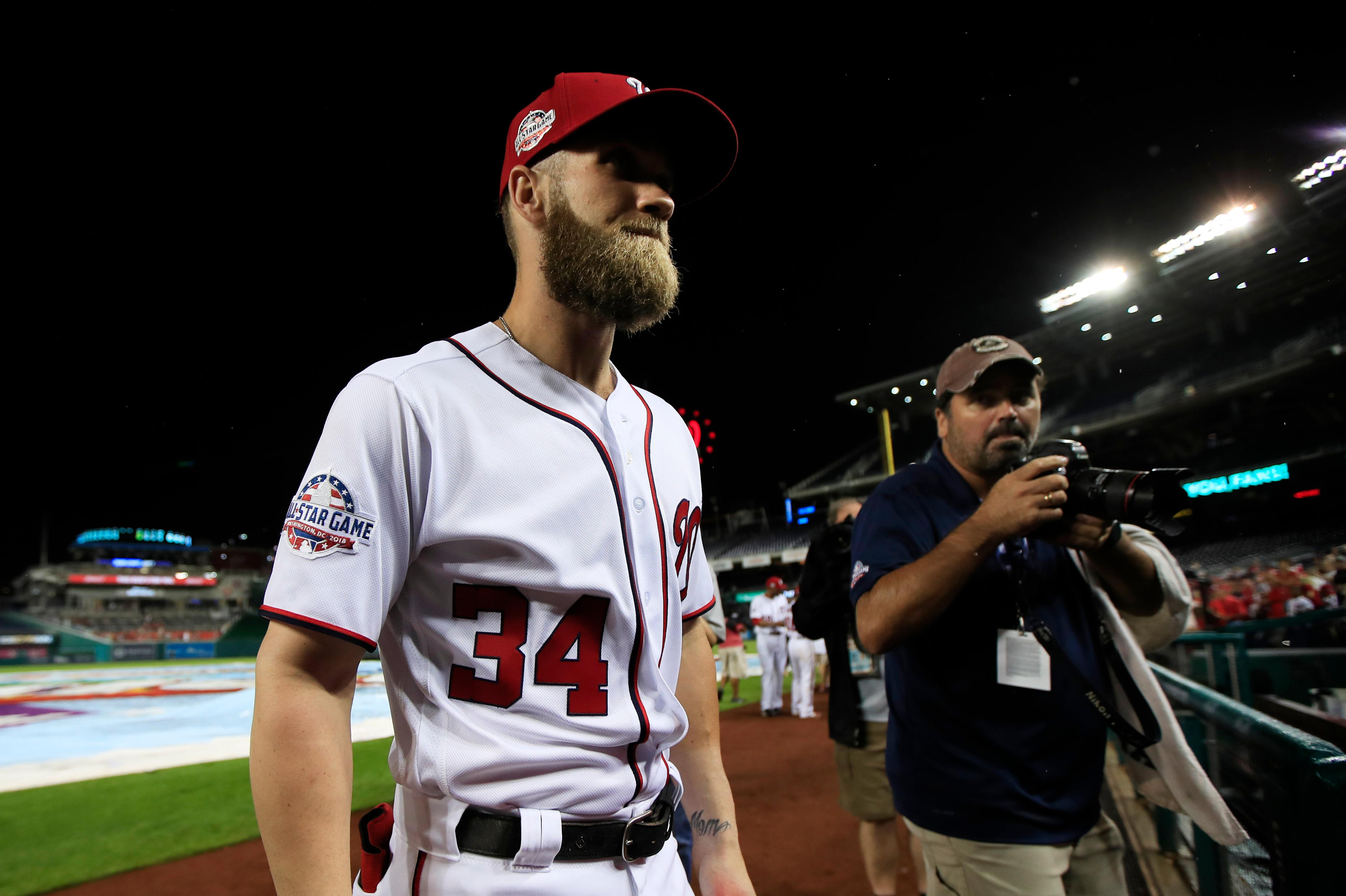 Washington Nationals Bryce Harper (34) leaves the field after the Nationals ended their last home game of the season with a 9-3 rain delayed win against the Miami Marlins in Washington, Wednesday, Sept. 26, 2018. (AP Photo/Manuel Balce Ceneta)