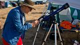Solar Port Eclipse Campground: Crowd gathers at airport to watch moon cover sun