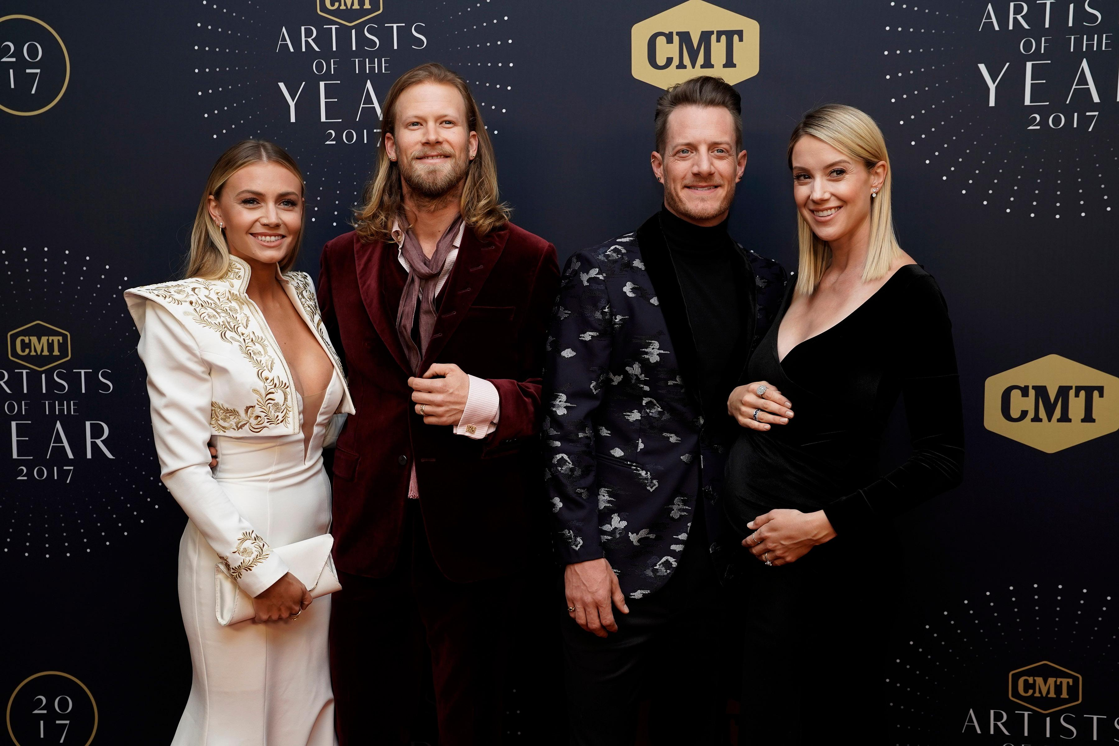 Florida Georgia Line, left, Brian Kelley with wife Brittney and Tyler Hubbard with wife Hayley seen at 2017 CMT Artists of the Year at Schermerhorn Symphony Center on Wednesday, Oct. 18, 2017, in Nashville, Tenn. (Photo by Sanford Myers/Invision/AP)