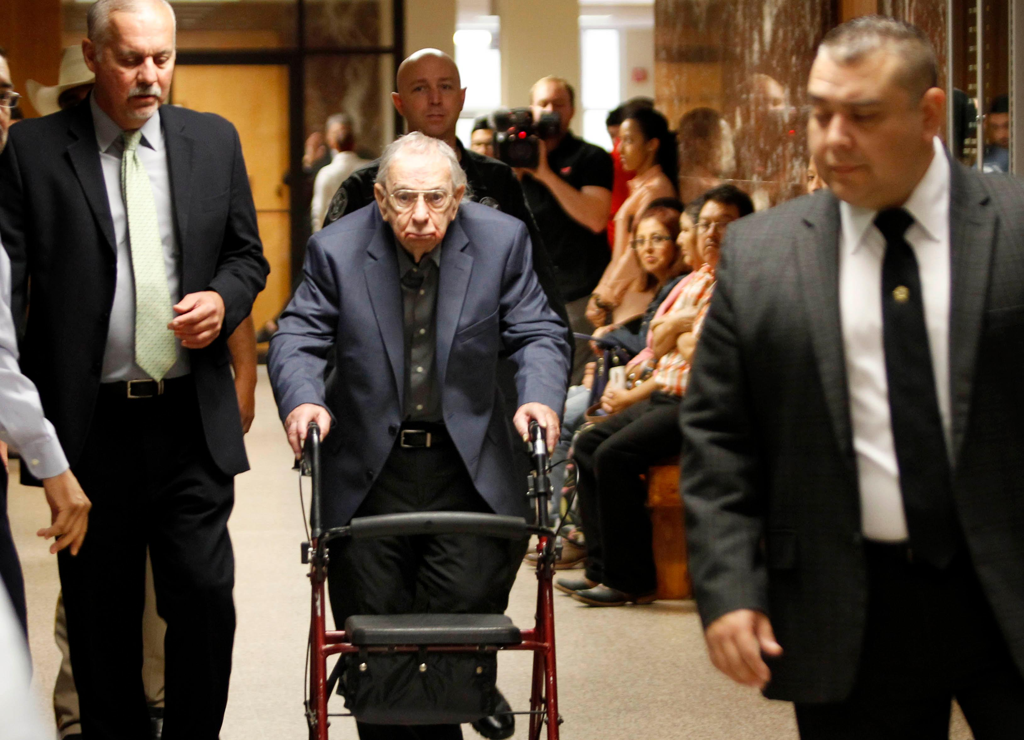 John Bernard Feit walks down the hallway to the 92nd state District Court for the third day of his trial for the murder of Irene Garza Monday, December, 4, 2017, at the Hidalgo County Courthouse in Edinburg.  (Nathan Lambrecht/The Monitor/Pool)