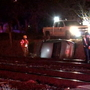 Car falls onto railroad tracks, driver flees on foot