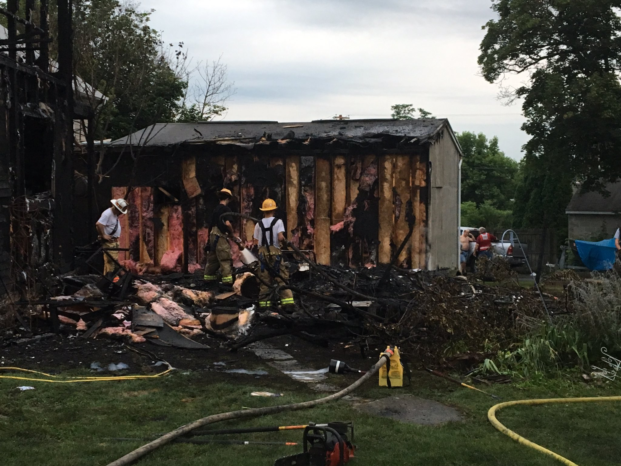 Two homes and a business ravaged by early morning fire